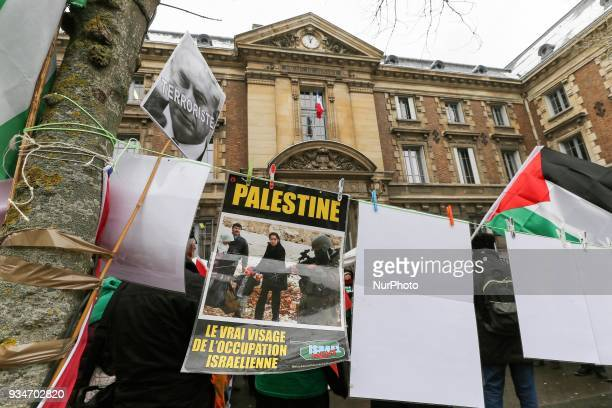 Signs againt Israel and Israeli Prime Minister Benjamin Netanyahu during a demonstration on March 19 in front of the court of Versailles near Paris...