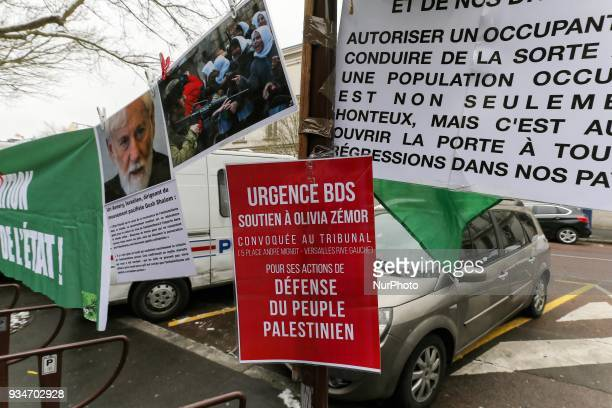 Signs againts Israel during a demonstration on March 19 in front of the court of Versailles near Paris in support of French political activist Olivia...