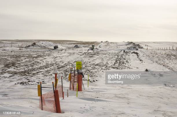 Signs along the path of covered pipe for the Keystone XL pipeline in Oyen, Alberta, Canada, on Tuesday, Jan. 26, 2021. U.S. President Joe Biden...