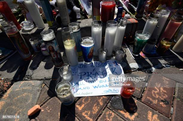 Signs and candles are displayed at a makeshift memorial set up across from the Las Vegas Village on October 4 2017 in Las Vegas Nevada The...