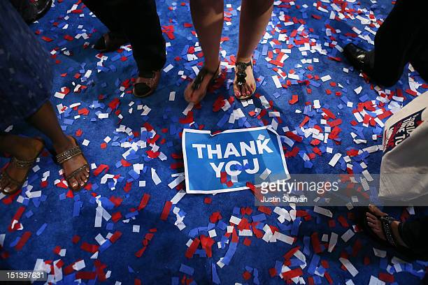 Signs and confetti sit on the floor after Democratic presidential candidate US President Barack Obama accepted the nomination during the final day of...