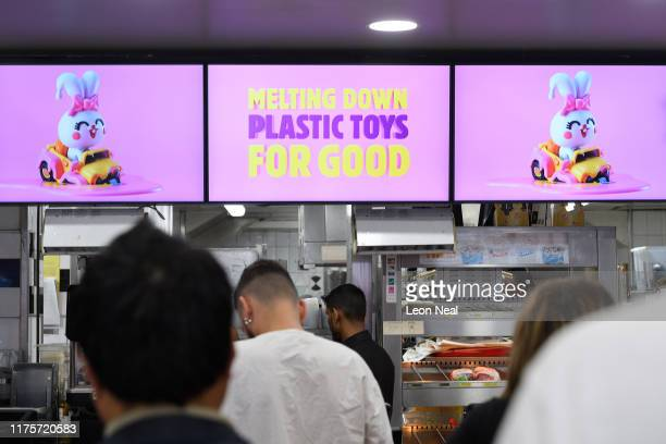 Signs and displays advertise the Burger King 'Meltdown promotion which has seen the chain remove plastic toys from their kids meal boxes inside a...