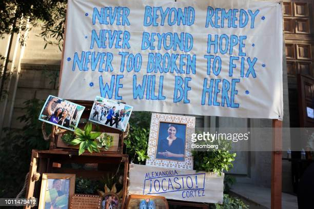 Signs and photographs sit on display outside an event for Alexandria OcasioCortez Democratic US Representative candidate from New York at the First...