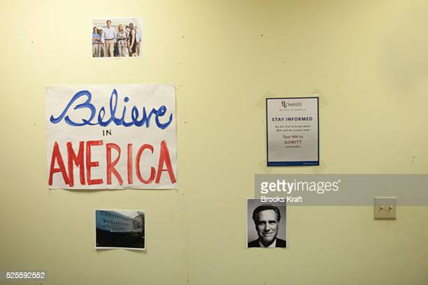 Signs and photos on the wall at Republican presidential candidate Mitt Romney's campaign headquarters in Manchester NH