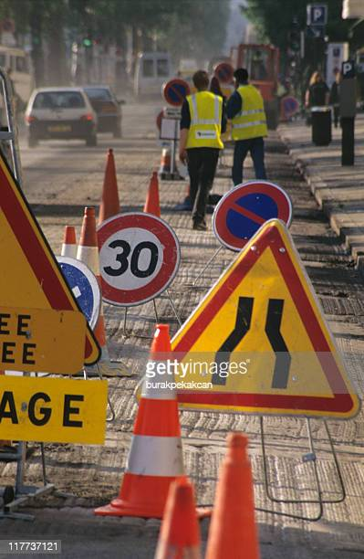 signs and roadworks in street, paris, france - paris fury stock pictures, royalty-free photos & images