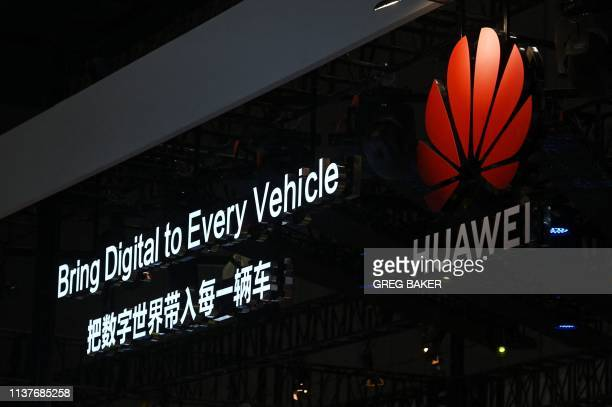 Signs are displayed at the Huawei stand at the Shanghai Auto Show in Shanghai on April 17 2019