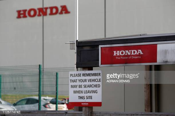 Signs are pictured outside of the Honda manufacturing plant in Swindon southwest England on February 19 2019 Honda announced Tuesday it would shut a...