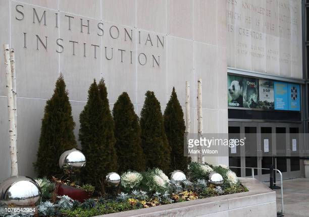 Signs are placed on the doors of the Smithsonian National Museum of American History stating that the museum is closed as the partial shutdown of the...