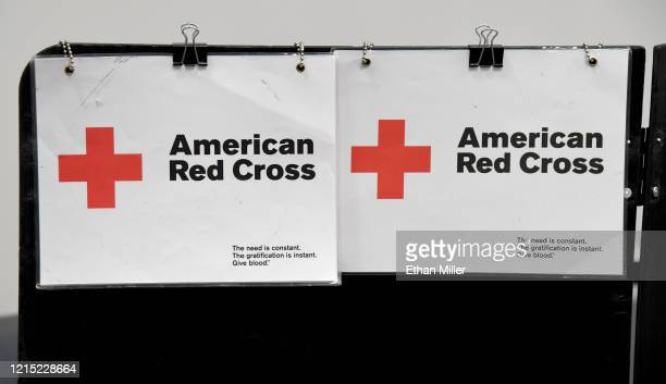 Signs are posted at an intake area during an American Red Cross blood drive to help alleviate a blood supply shortage as a result of the coronavirus...