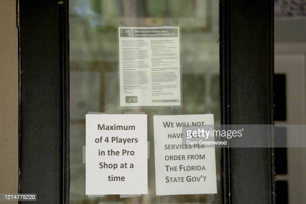 Signs are posted at Windsor Parke Golf Club which is open for business amid the Coronavirus outbreak on March 25 2020 in Jacksonville Beach Florida...