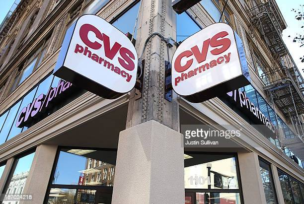 Signs are posted outside of a CVS store on November 5 2013 in San Francisco California CVS Caremark reported a 25 percent surge in thirdquarter...