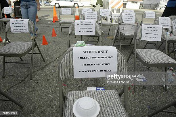 Signs are posted to seats signifying the continuing segregation in the education system during a demonstration for equal access to education for low...