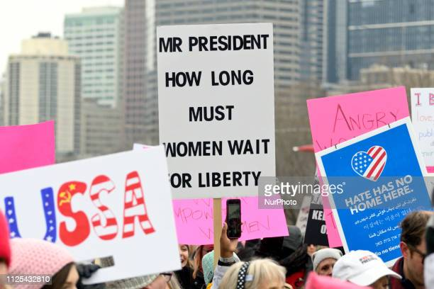 Signs are raised in the air as thousands gathered in Center City Philadelphia PA to partake in protests during the third annual Women's March on...