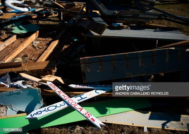 Signs are seen amongst debris near a destroy house in Port St Joe beach Florida on October 13 three days after hurricane Michael hit the area Since...