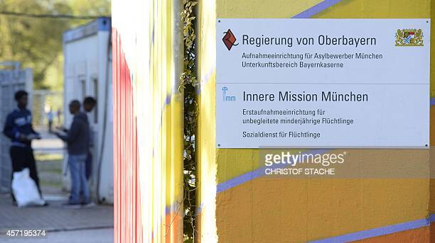 Signs are seen at the central place where newly arrived refugees have to register near the Bayernkaserne refugee accommodation in Munich southern...