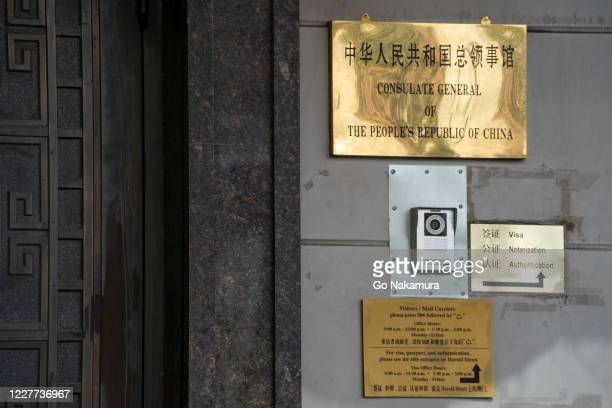 Signs are seen at the Chinese consulate after the United States ordered China to close its doors on July 22, 2020 in Houston, Texas. According to the...