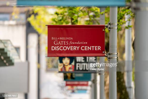 Signs are seen outside of the Bill and Melinda Gates Foundation on May 4, 2021 in Seattle, Washington. Bill Gates and Melinda Gates announced their...