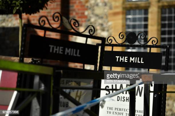 Signs are seen outside The Mill pub close to The Maltings shopping centre in Salisbury southern England on March 8 2018 which was closed in...