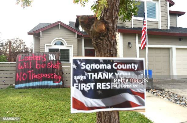 Signs are seen posted in the Coffey Park area of Santa Rosa California on October 20 2017 Residents are being allowed to return to their burned homes...