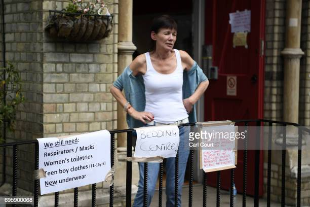 Signs asking for donations are seen outside the Notting Hill methodist Chruch June 14 2017 in London England The Mayor of London Sadiq Khan has...