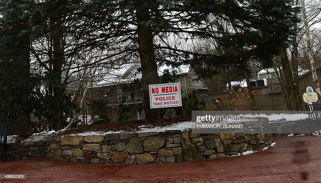 Signs asking media to stay away are seen in the sandy hook