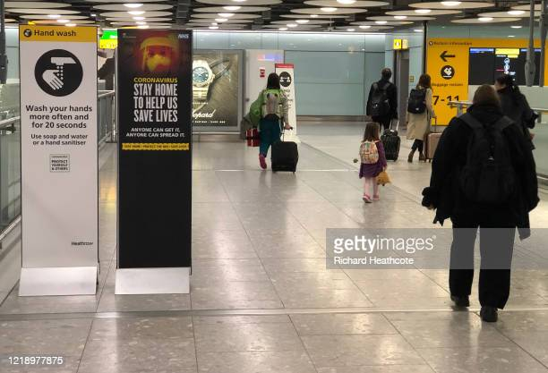 Signs asking people to stay at home in Terminal 5 at Heathrow Airport on April 15 2020 in London United Kingdom The airport expects 90% fewer...
