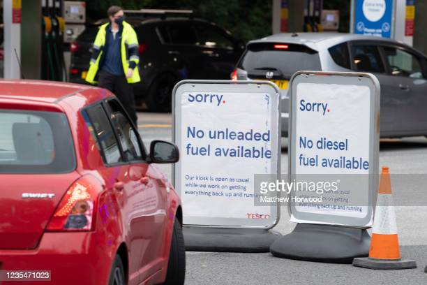 Signs at a Tesco Extra petrol station off Western Avenue which has run out of unleaded and diesel fuel but still has supplies of super unleaded fuel...