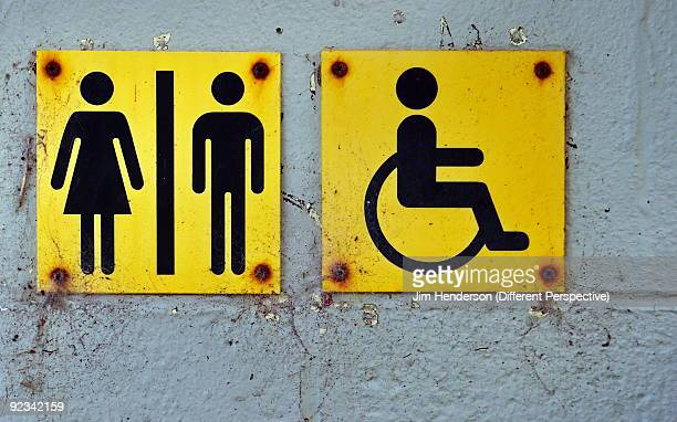 signs at beach side - disabled sign stock photos and pictures