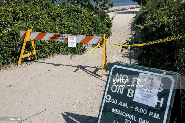 Signs at the entrance to East End Beach tell beachgoers that it is temporarily closed on Sunday, July 19, 2020. The beach was closed Sunday afternoon...