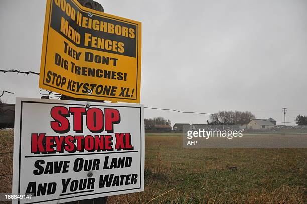 Signs attached to a fence on the property of Jim Tarnick a farmer opposed to the controversial Keystone XL pipeline are pictured April 17 2013 in...