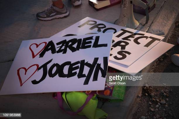 Signs bearing the names of alleged victims of singer R Kelly lay on the ground before the start of a demonstration near his studio prompted by...