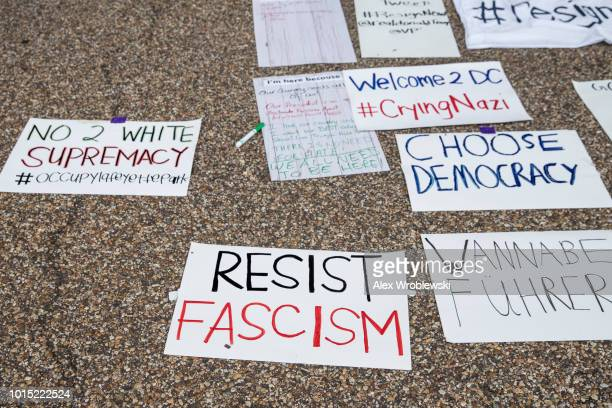 Signs belonging to antifascist protesters lay on display at Lafayette Square on August 11 2018 in Washington DC A 'Unite the Right' rally featuring...