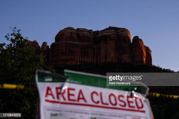 Signs block the entrance to the currently closed Cathedral Rock Trail on Wednesday April 22 2020 in Sedona AZ In early April in an attempt to slow...