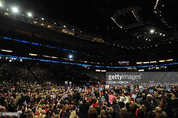 Signs crowd the floor as John McCain, Republican presidential nominee, gives his acceptance speech during the Republican National Convention 2008 at...
