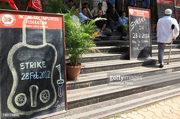 Signs declaring a stand sit outside Income Tax office at Church Gate on on February 28 2012 in Mumbai India Transportation and Banking services were...