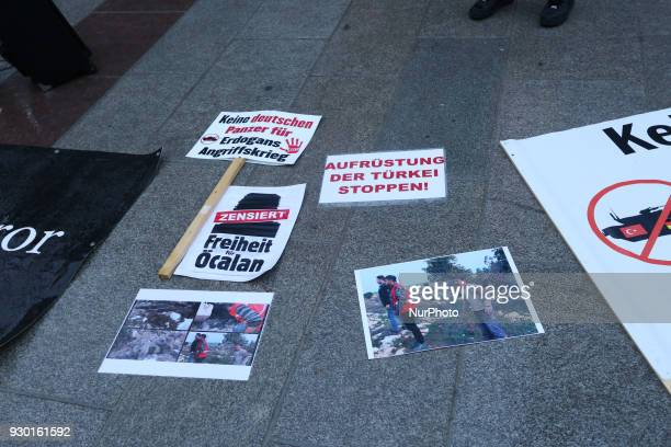 Signs demanding freedom for Abdullah Oecalan and to stop arms export to Turkey Some activists made a flashmob for the kurdish region and city in...
