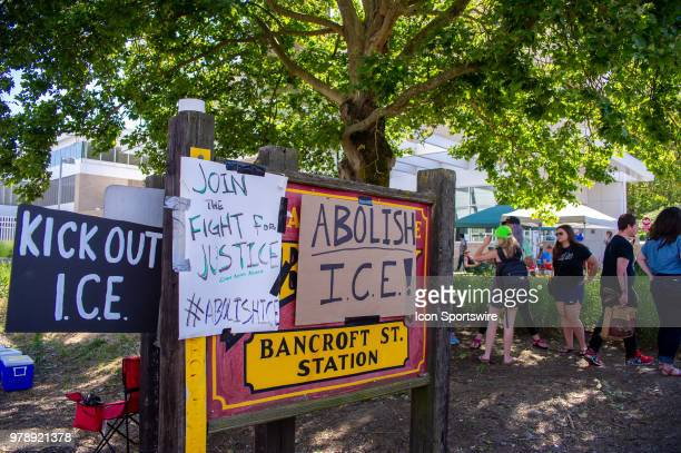 Signs denouncing ICE are posted on the historic board of Barncorft St Trolly Station at OccupyICEPDX just in front of the ICE Portland Headquarters...