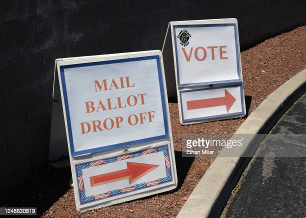 Signs direct people to the entrance of the Clark County Election Department which is serving as both a primary election ballot dropoff point and an...