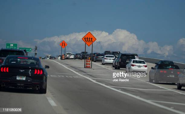 Signs direct traffic at a road construction site on State Road 836 on May 22 2019 in Miami Florida President Donald Trump walked out of a meeting...