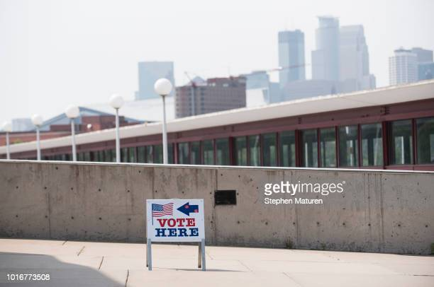 Signs direct voters outside the Weisman Art Museum polling place during the 2018 Minnesota primary election on August 14 2018 in Minneapolis...