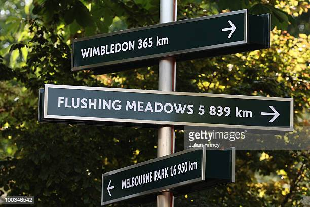 Signs display the distances to Wimbledon Flushing Meadows and Melbourne Park from Roland Garros during day one of the French Open at Roland Garros on...