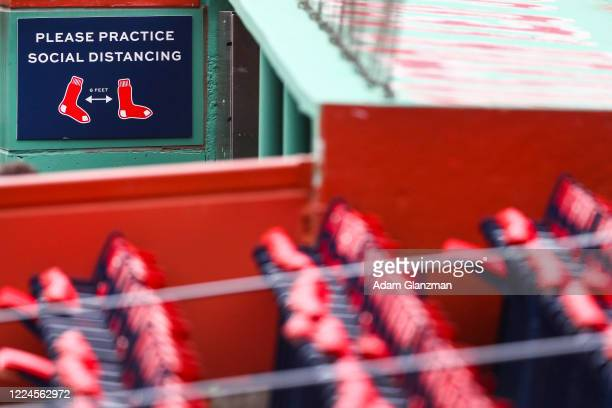 Signs encouraging social distancing sit in etc Boston Red Sox dugout during a Summer Workout at Fenway Park on July 3, 2020 in Boston, Massachusetts.