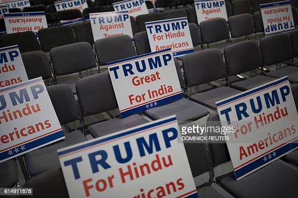 Signs expressing Hindu support for Republican presidential candidate Donald Trump are seen during a Hindu political organization's antiterror...