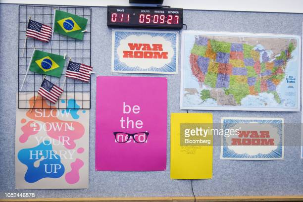 Signs flags and a map hang on a wall inside Facebook Inc election War Room at Facebook Inc headquarters in Menlo Park California US on Wednesday Oct...