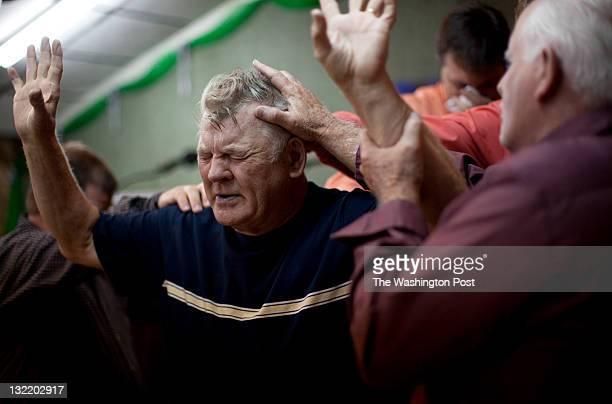 'Signs Following' Pentecostals lay their hands on William Payne during a service at the Church of the Lord Jesus in Jolo West Va on Sept 3 2011...