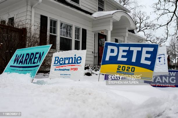 Signs for a number of different candidates are staked in the lawn outside of a home in Des Moines Iowa on January 25 2020 With nine days to go...