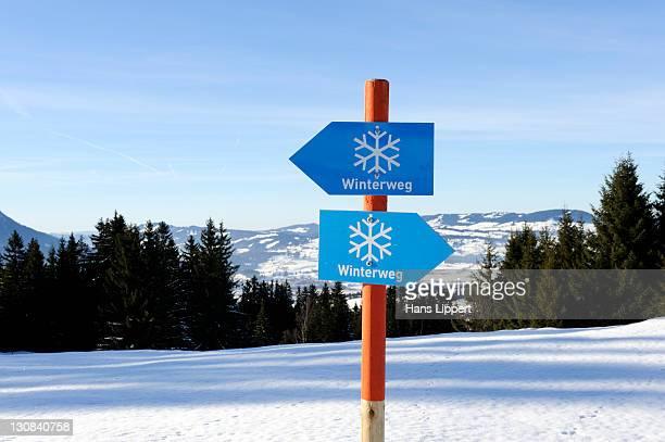 Signs for a winter trail, panorama walk on Mt. Gruenten, Upper Allgaeu, Swabia, Bavaria, Germany, Europe