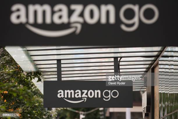 Signs for Amazon Go are seen outside the grocery store's location on June 16 2017 in Seattle Washington Amazon announced that it will buy Whole Foods...