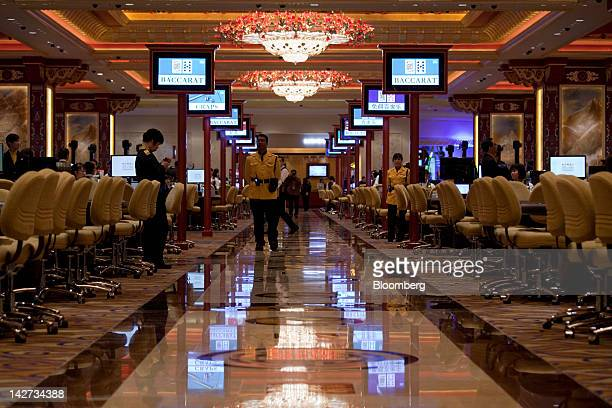 Signs for Baccarat and Craps tables are displayed in the Sands Cotai Central casino resort in Macau China on Wednesday April 11 2012 Las Vegas Sands...