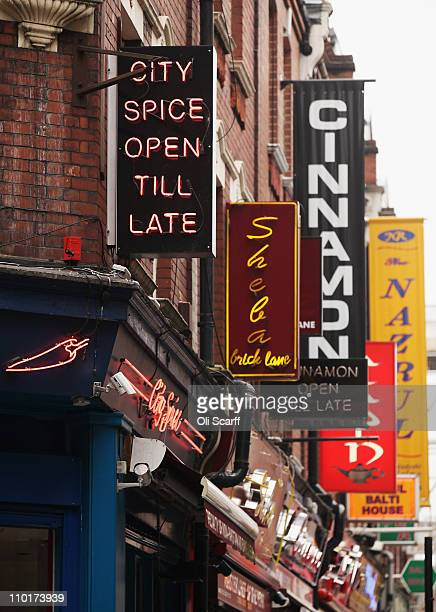 Signs for businesses on Brick Lane which is synonymous with curry restaurants on March 16 2011 in London England From April 2011 the Government has...